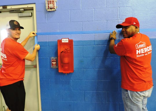 Frank Radziwon, left, and Eric Perry prepare to paint at the Hobe Sound Boys & Girls Club improvement project spearheaded by Lowe's employees.