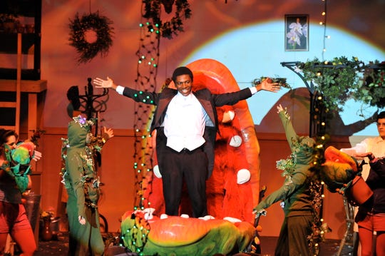 Jamari Johnson Williams takes his first curtain call at St. Ed's for his role as the man-eating plant in 'Little Shop of Horrors.'