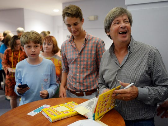 Dave Barry (right) shares a laugh with admirers of his writing Thursday, Sept. 8, 2016, while signing copies of his most recent book for Spencer Friedberg (left) and Jonathan Buckley after giving a talk at the Waxlax Center for the Performing Arts at St. Edward's School in Vero Beach. The Florida-born author spoke about his new book 'Best. State. Ever.: A Florida man defends his homeland' in which Barry celebrates the state's uniqueness. Barry wrote columns for the Miami Herald, is a recipient of the Pulitzer Prize for commentary and has authored more than 30 books.