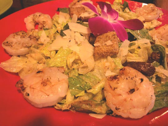 Cajun Cove Reboot's  Caesar salad and lightly blackened grilled shrimp.