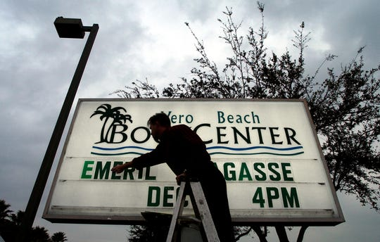 Matthew Shelmandine, an employee at the Vero Beach Book Center changes the store marquee to announce the visit of Emeril Lagasse. The famous chef signed books for fans on Dec. 10, 2003, at the book center. He returned for a second visit in 2009.