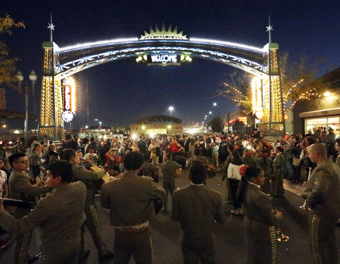 A mariachi group performs at the grand opening of the Paseo de Las Luces project along the South El Paso Street shopping corridor Wednesday night in South El Paso. The new archway greeting drivers coming over the Paso Del Norte international bridge was lit during the ceremony which was attended by dignitaries from El Paso and Juarez, including mayor Dee Margo and his Juarez counterpart, Alfonso Cabada .