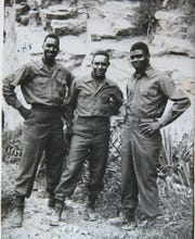 Edward Greer, left, with two fellow soldiers somewhere in Europe during World War II. He began his military service in a segregated Army.