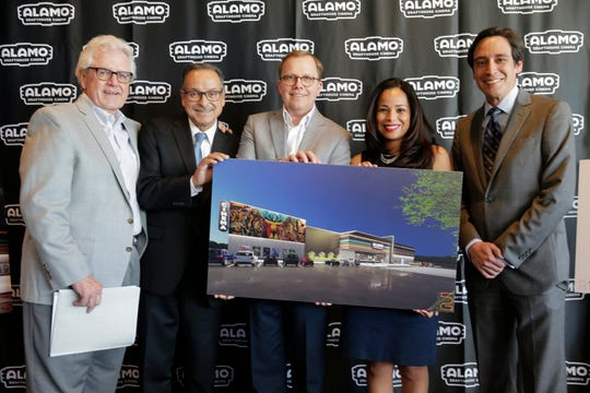 John Folmer, RJL Real Estate Consultants, County Commissioner Carlos Leon, Neil Billinsley-Michaelson, CEO and President of Triple Tap Ventures along with City Rep. Claudia Ordaz-Perez and County Commissioner Vince Perez hold an artist rendition of the new Alamo Drafthouse Cinema which is going to be built on El Paso's East Side. The new location will  be built at the intersection of Loop 375 and Pelicano Dr. and is expected to open in early 2020.