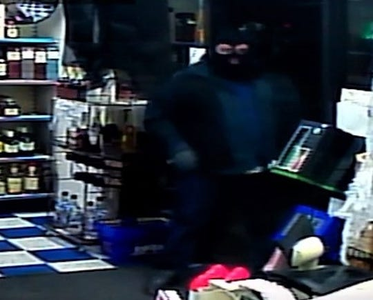 Security camera image of an Oct. 22 robbery of Barrel House Liquors in the Ranchland Village shopping strip in El Paso.