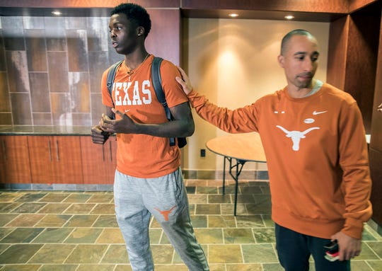 University of Texas head basketball coach Shaka Smart, right, on Oct. 31, 2018, in Austin meets with University of Texas basketball player Andrew Jones before Jones discussed his leukemia diagnosis and his plans for the upcoming basketball season now that he is in remission.