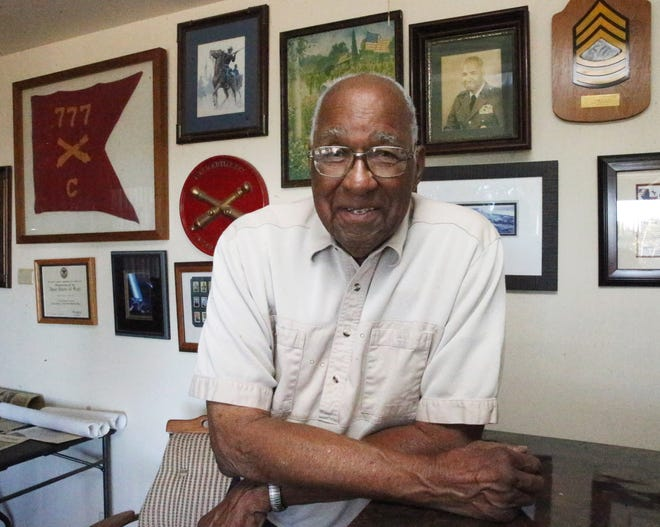 Retired Maj. Gen. Edward Greer stands in his military room at his Northeast El Paso home. Greer, 94, who began his military career during World War II in Europe, moved to El Paso with his wife, Jewell, in 1976 from Washington, D.C.