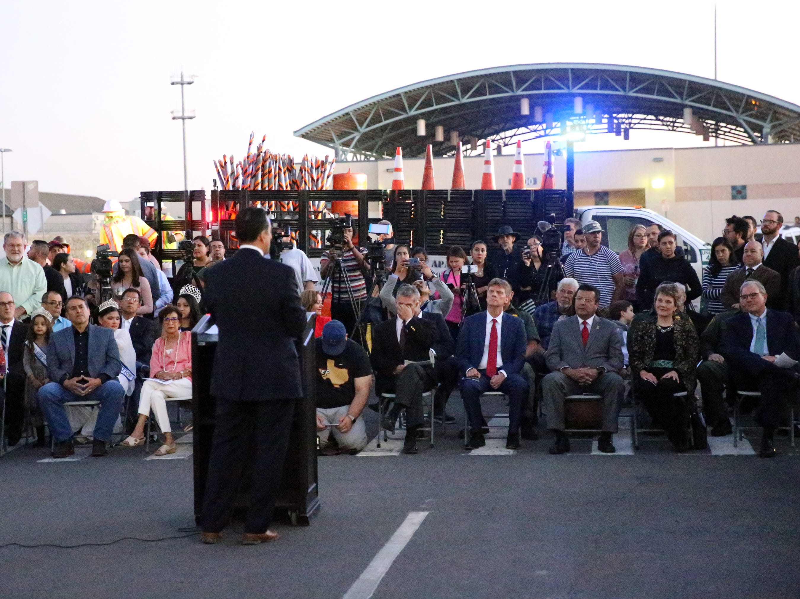 City manager Tommy Gonzalez speaks in the middle of South El Paso Street during the grand opening of the Paso de Las Luces Wednesday night in South El Paso.