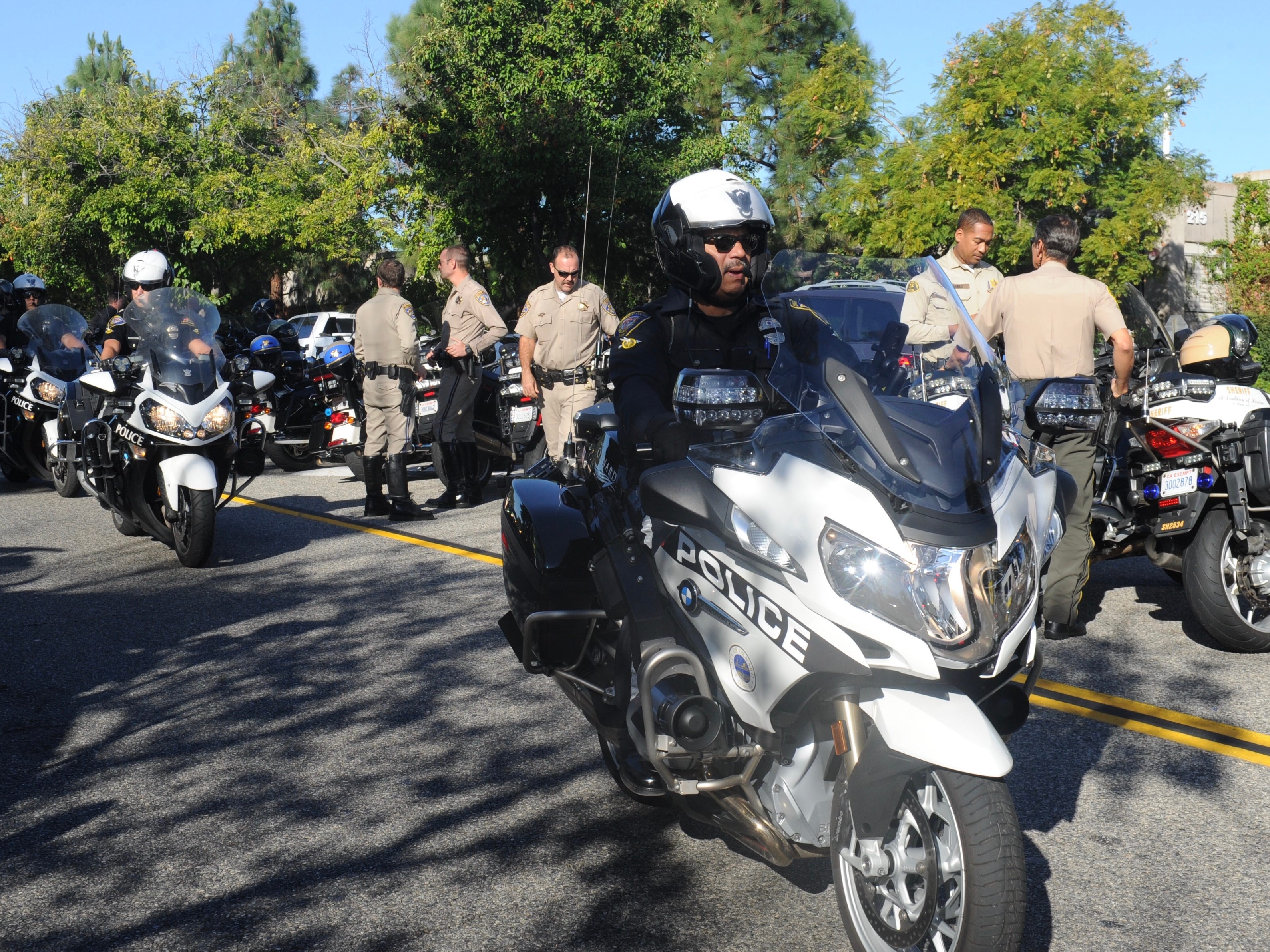 Dozens of motorcycle officers from around the region prepare for the procession of Sgt. Ron Helus' body from Los Robles Regional Medical Center Thursday morning.