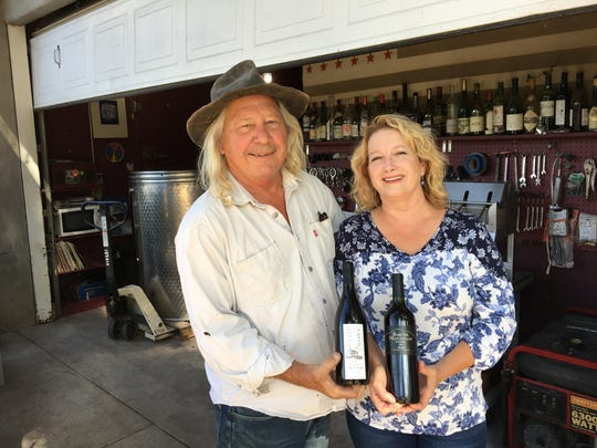 Bruce Freeman and Gretel Compton, co-winemakers for Clos des Amis and South Mountain Winery, pose just outside the adobe building that serves as their winemaking space in a citrus orchard between Somis and Santa Paula. The Clos des Amis label focuses on wines made from Ventura County-grapes.
