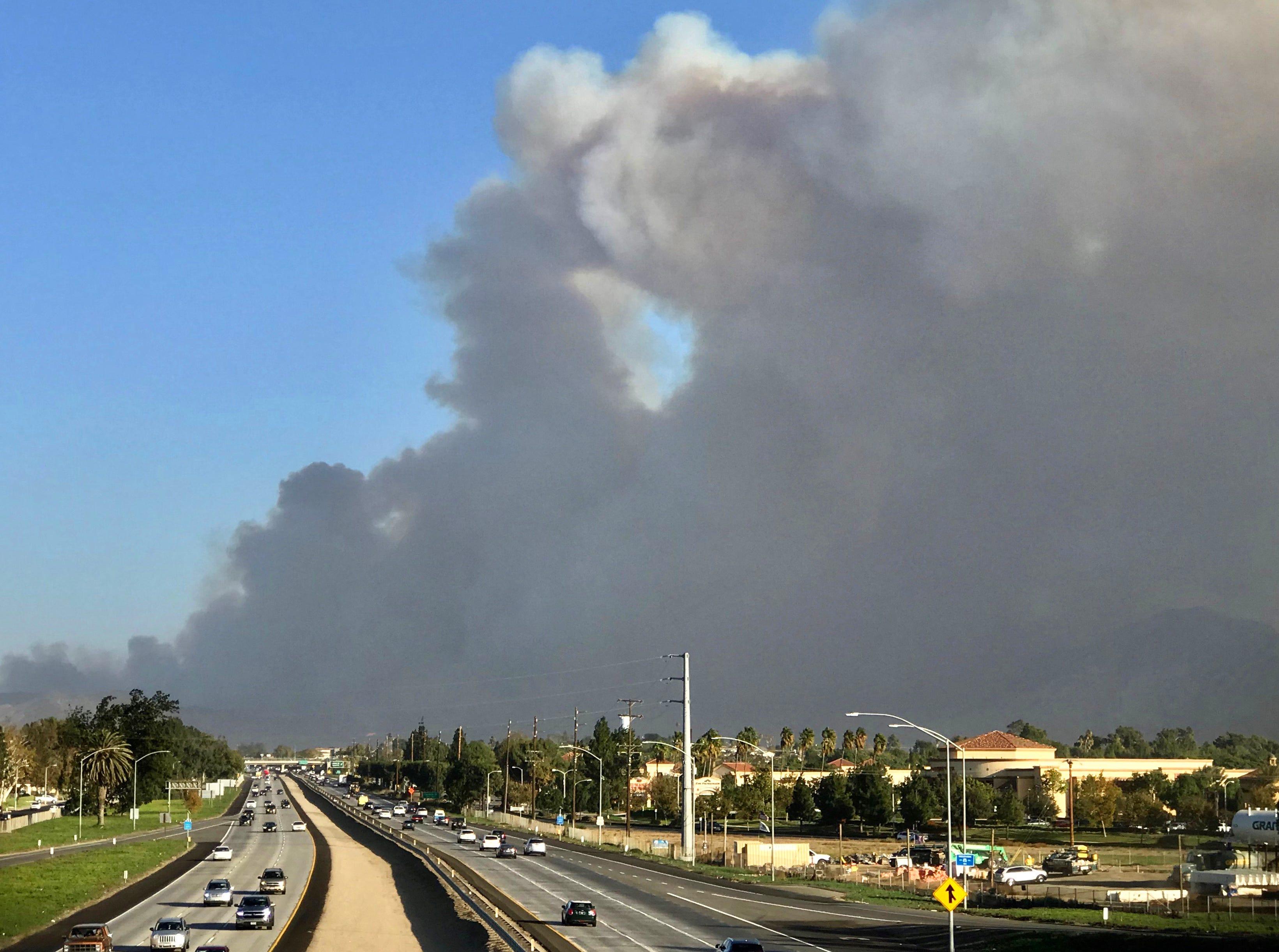 Smoke covers the sky above Highway 101 as the Hill Fire moves through the Santa Monica Mountains near Camarillo on Thursday.
