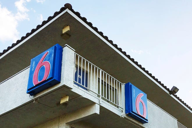 This Sept. 14, 2017, file photo shows a Motel 6 in Phoenix. The chain has agreed in a proposed settlement to pay up to $7.6 million to guests who say the company's employees shared their private information with immigration officials.