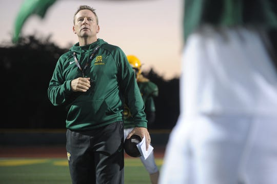 Head coach Ryan Huisenga oversees Moorpark High's practice Wednesday night. The Musketeers host Sierra Canyon in a Division 3 quarterfinal game Friday night.