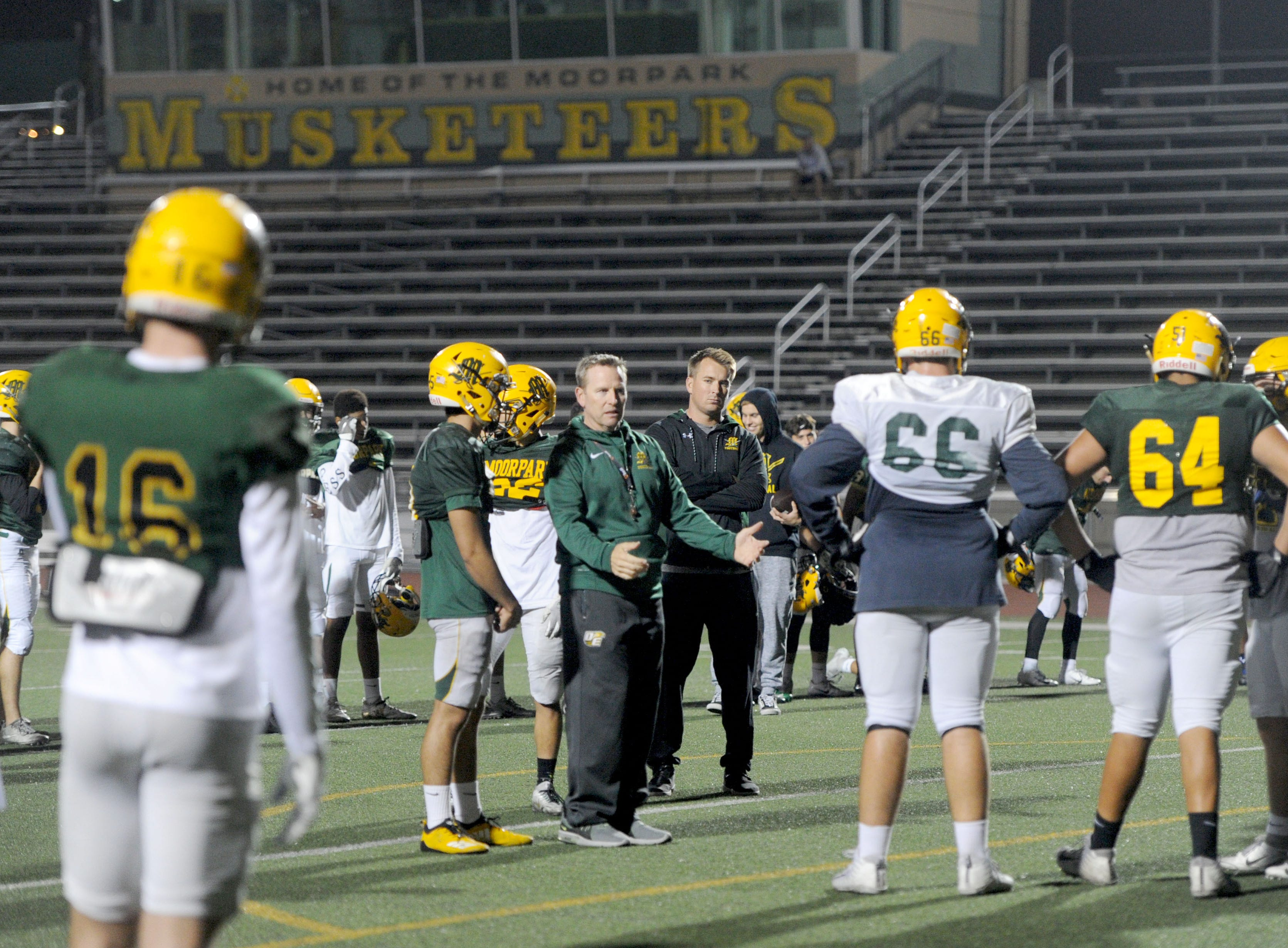Head coach Ryan Huisenga takes a moment for instruction during Moorpark's practice Wednesday. The Musketeers host Sierra Canyon in a Division 3 quarterfinal game Friday night.
