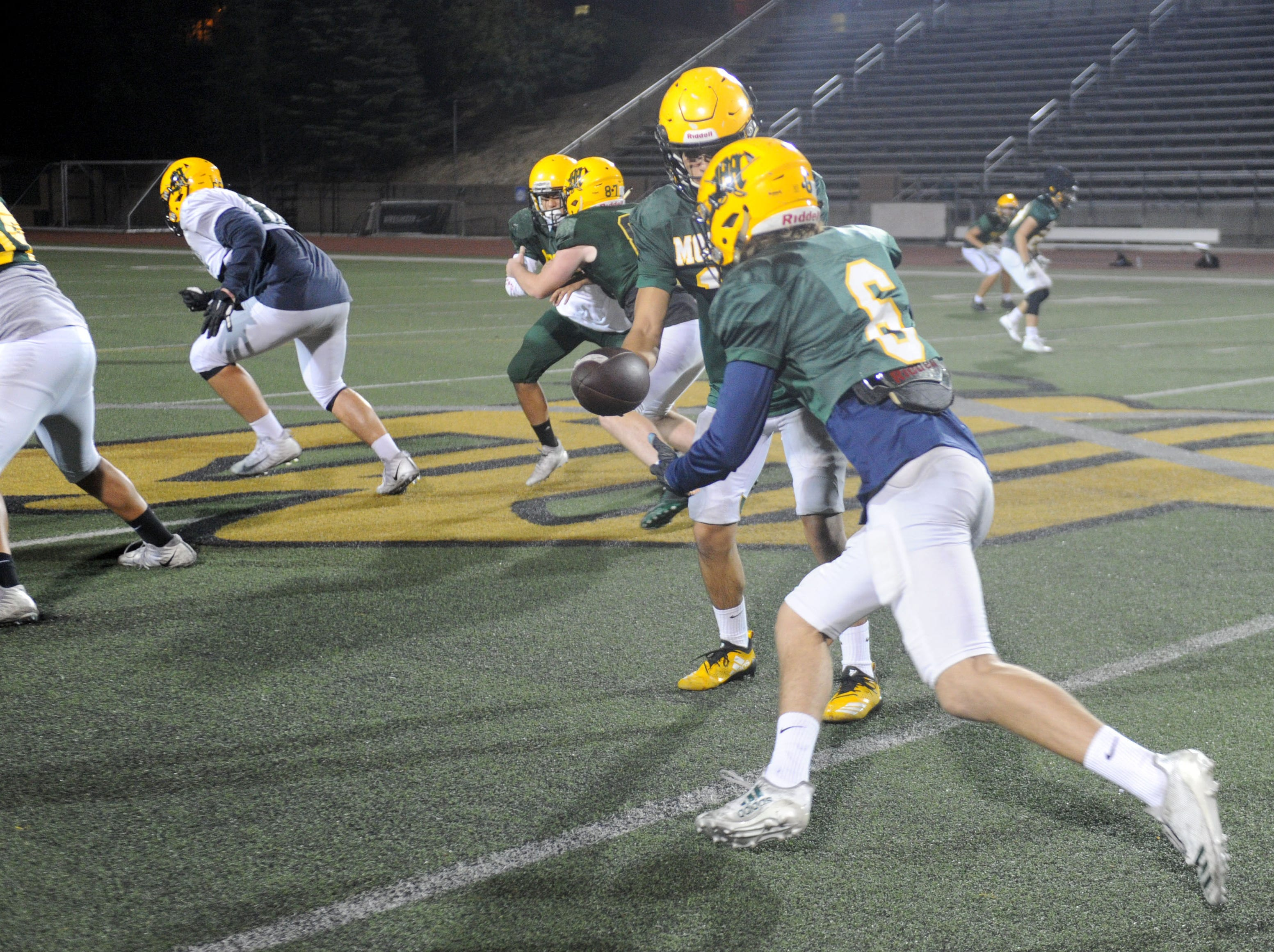 Ian Meier takes a handoff during Moorpark's practice Wednesday. The Musketeers host Sierra Canyon in a Division 3 quarterfinal game Friday night.