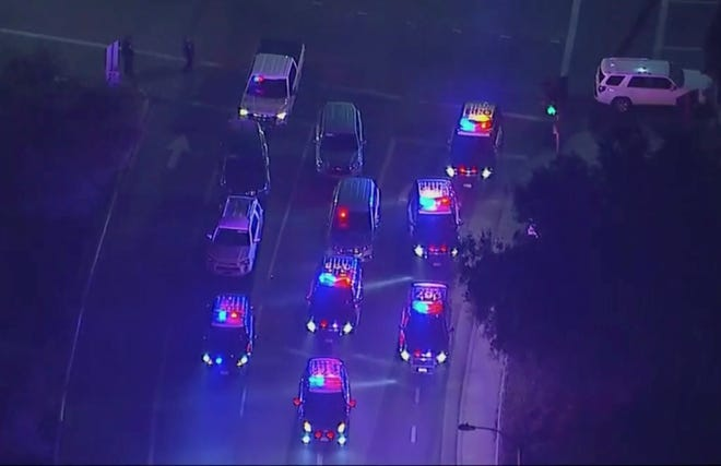 In this image made from aerial video, police vehicles block an intersection in the vicinity of a shooting in Thousand Oaks early Thursday after a mass shooting at the Borderline Bar & Grill.