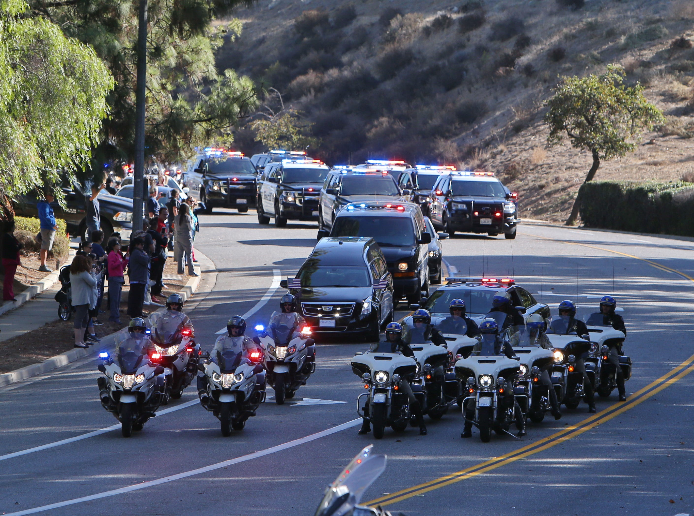 The procession leave Los Robles Hospital Thursday as it escorts Ventura County Sheriff Sgt. Ron Helus, who was killed inside the Borderline Bar and Grill in Thousand Oaks late Wednesday during a mass shooting.