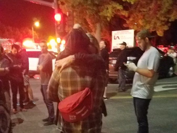 People outside the Borderline Bar & Grill hug after a shooting in the Thousand Oaks Country Music venue Wednesday night.
