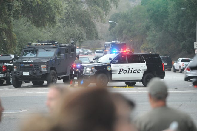 A SWAT vehicle and dozens of police cars close off portions of the street near Borderline Bar & Grill in Thousand Oaks, the scene of a mass shooting Wednesday night.