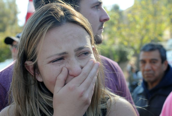 Alexis Tait, 23, cries at the procession of Sgt. Ron Helus' body at Los Robles Regional Medical Center Thursday morning. She had friends that were killed at the shooting at the Borderline Bar & Grill Wednesday night in Thousand Oaks.