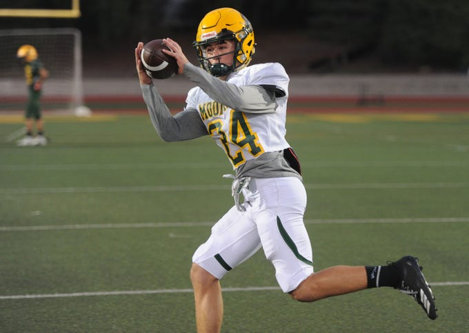 Noah Cronquist makes a catch during Moorpark High's practice Wednesday night. The Musketeers host Sierra Canyon in a Division 3 quarterfinal game Friday night.