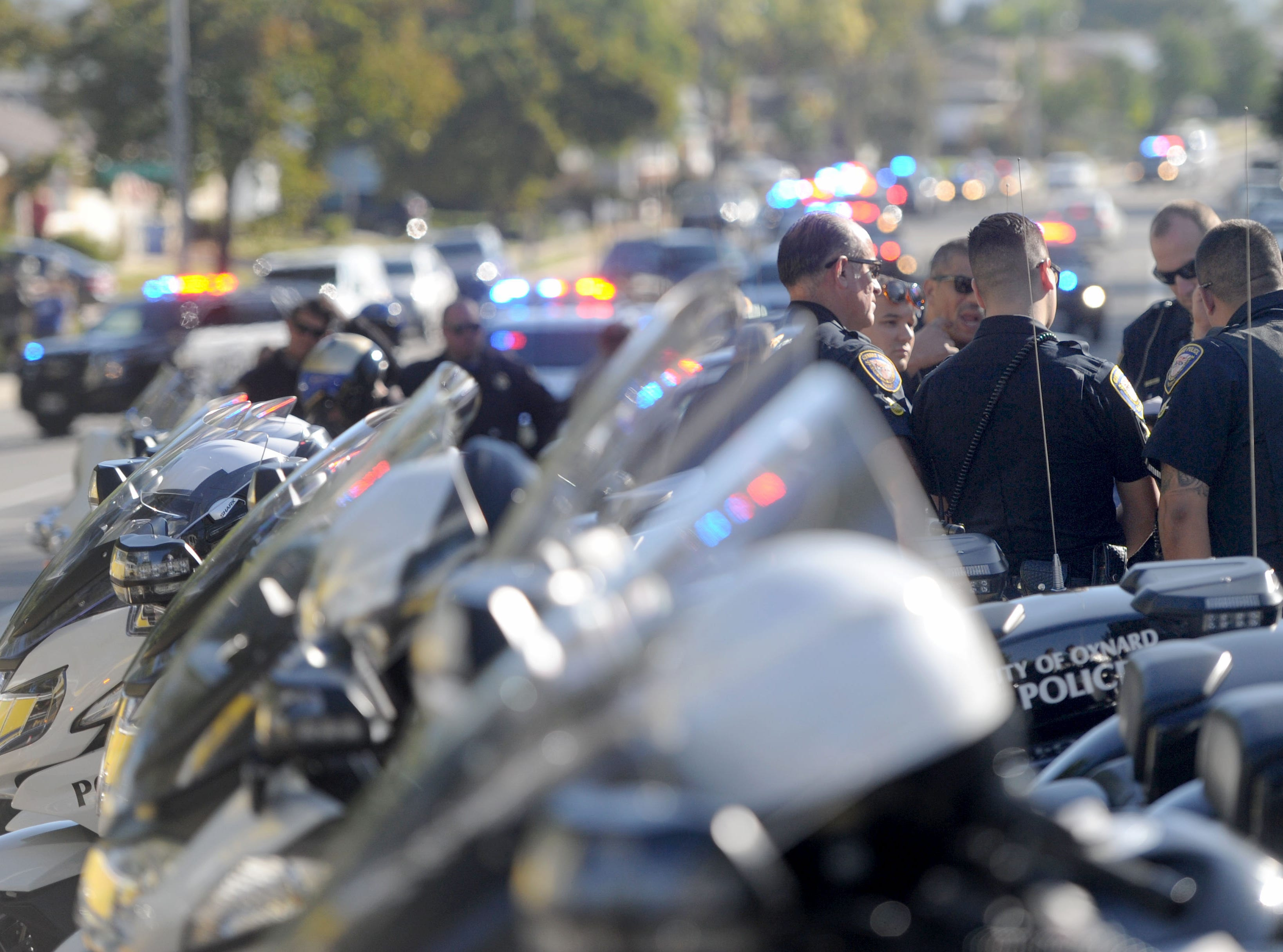 Oxnard police gets ready at the procession of Sgt. Ron Helus' body at Los Robles Regional Medical Center Thursday morning. He was killed at the shooting at the Borderline Bar & Grill Wednesday night in Thousand Oaks.