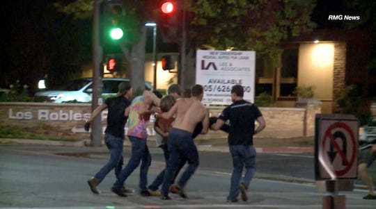 In this image taken from video, a victim is carried from the scene of a shooting, Wednesday in Thousand Oaks.  A hooded gunman dressed entirely in black opened fire on a crowd at a the Borderline Bar & Grill holding a weekly college night, killing 12 people and sending hundreds fleeing, including some who used barstools to break windows and escape, authorities said Thursday. The gunman was later found dead at the scene.