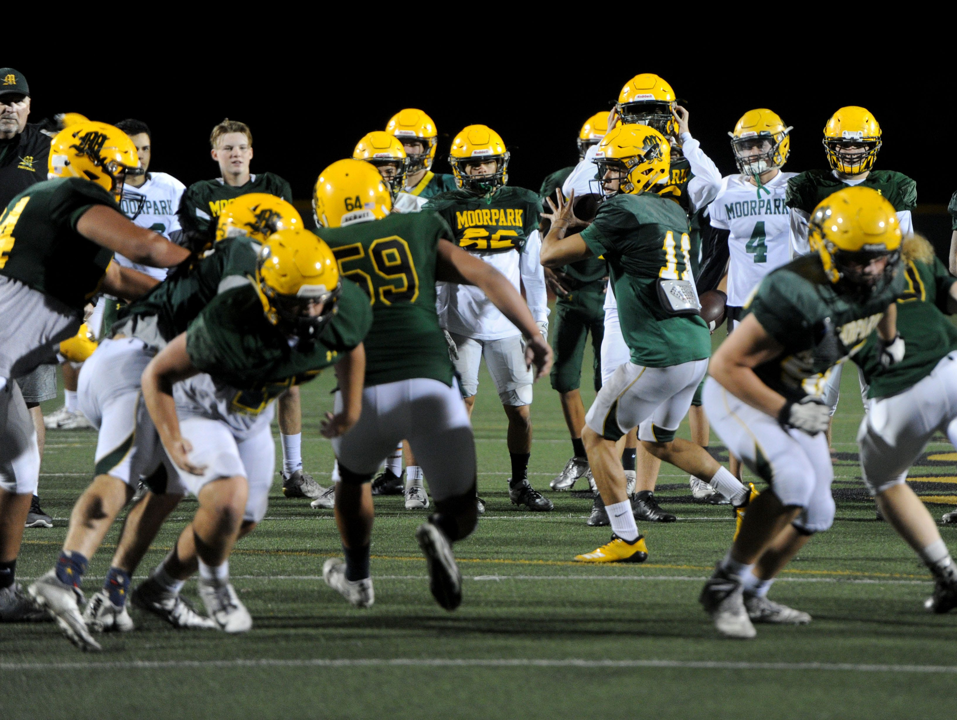 Moorpark High goes through plays during Wednesday's practice. The Musketeers host Sierra Canyon in a Division 3 quarterfinal game Friday night.
