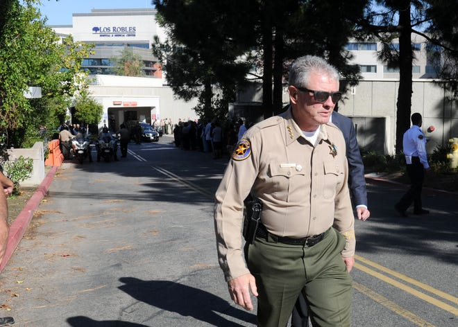 Sheriff Geoff Dean attends the  procession of Sgt. Ron Helus' body at Los Robles Regional Medical Center  Thursday morning. He was killed at the shooting at the Borderline Bar & Grill Wednesday night in Thousand Oaks.