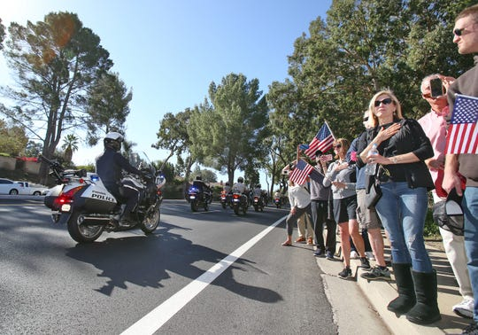 Members from the community pay their respects to Ventura County Sheriff Sgt. Ron Helus as a procession leaves Los Robles Hospital in Thousand Oaks. Helus was killed inside the Borderline Bar and Grill in Thousand Oaks late Wednesday, Nov. 7, 2018, when 13 people died, including the gunman, in a mass shooting.