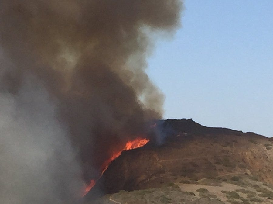 The Hill Fire in the Santa Rosa Valley burns up a hillside Thursday afternoon.
