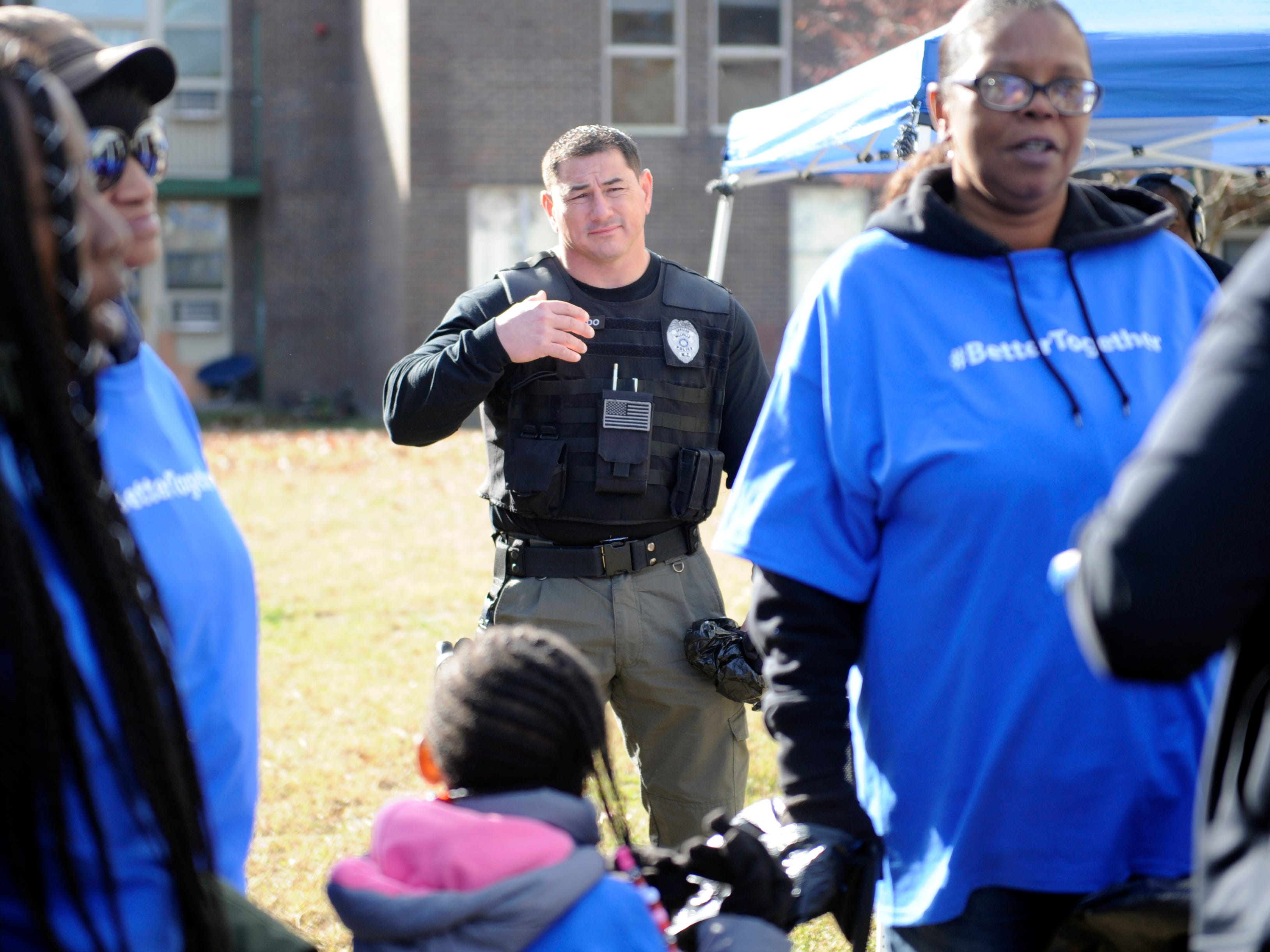 Millville residents, city officials and members of the police department create a stronger sense of community during a special property clean up event at Oakview Apartments on Thursday, November 8, 2018.
