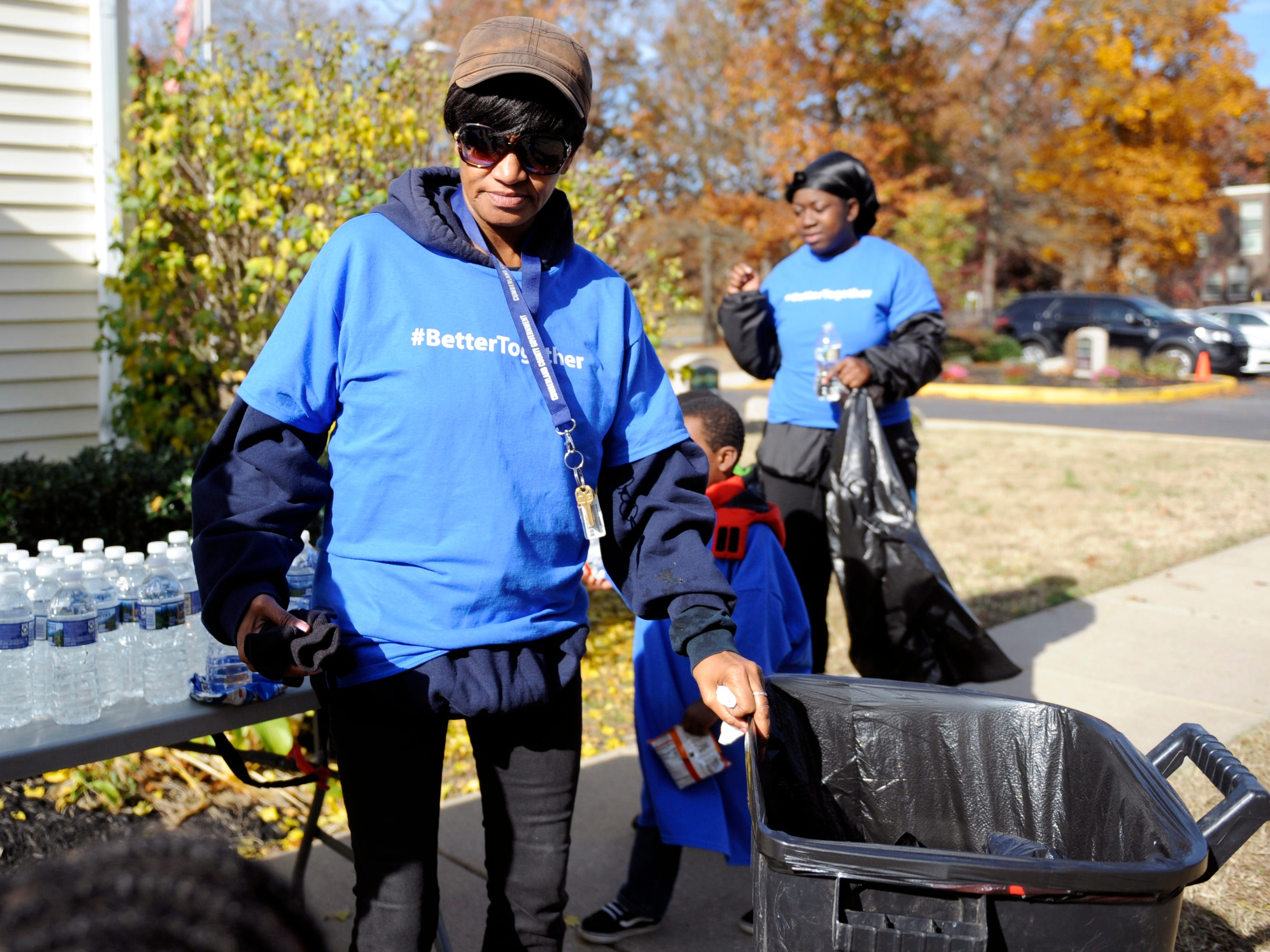 Oakview Apartments resident Angela Pernell helps out during a community clean up event in Millville.