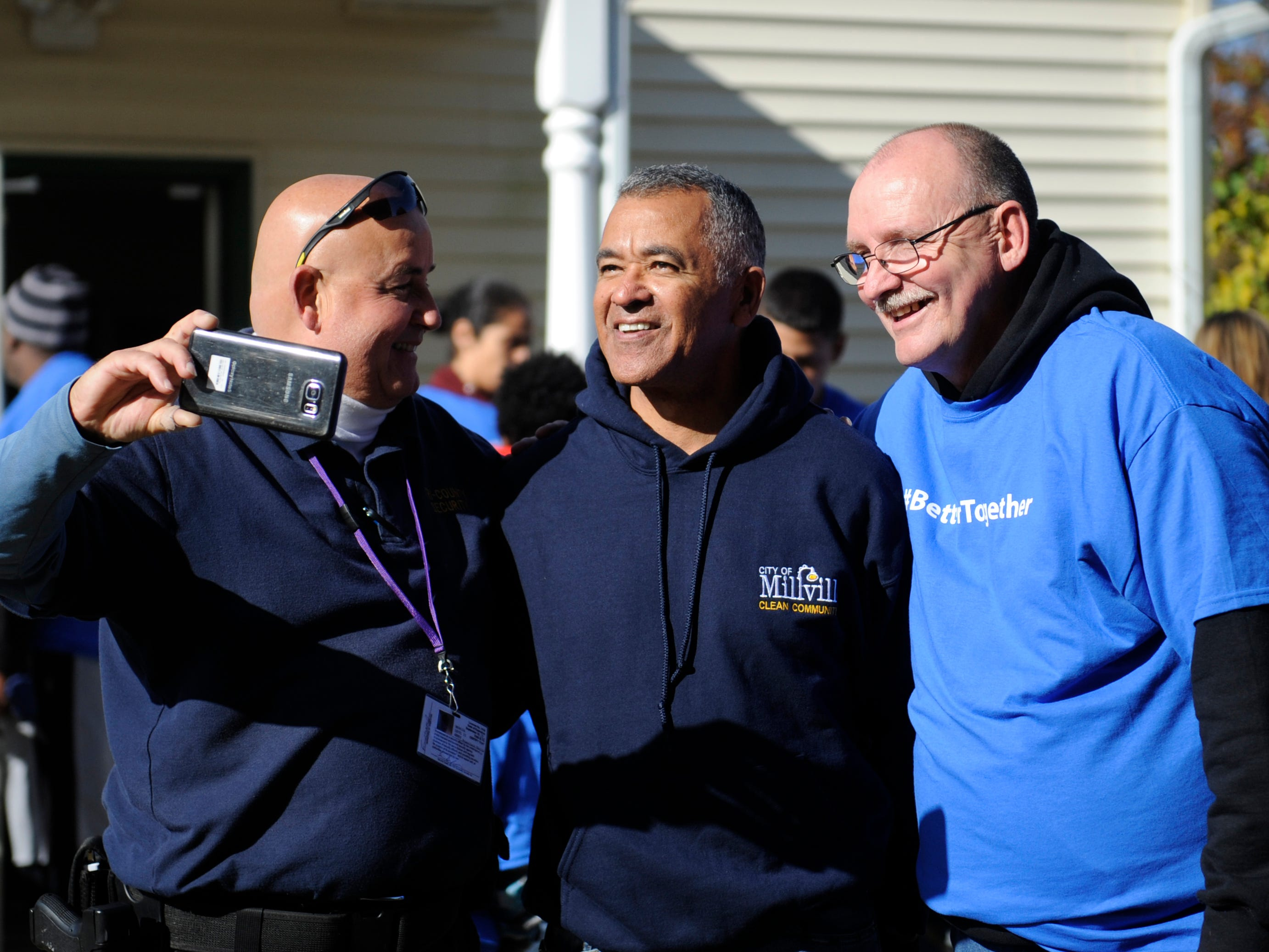 Millville Mayor Michael Santiago (center) poses for a picture with Oakview Apartments clean up volunteers during a special community event.