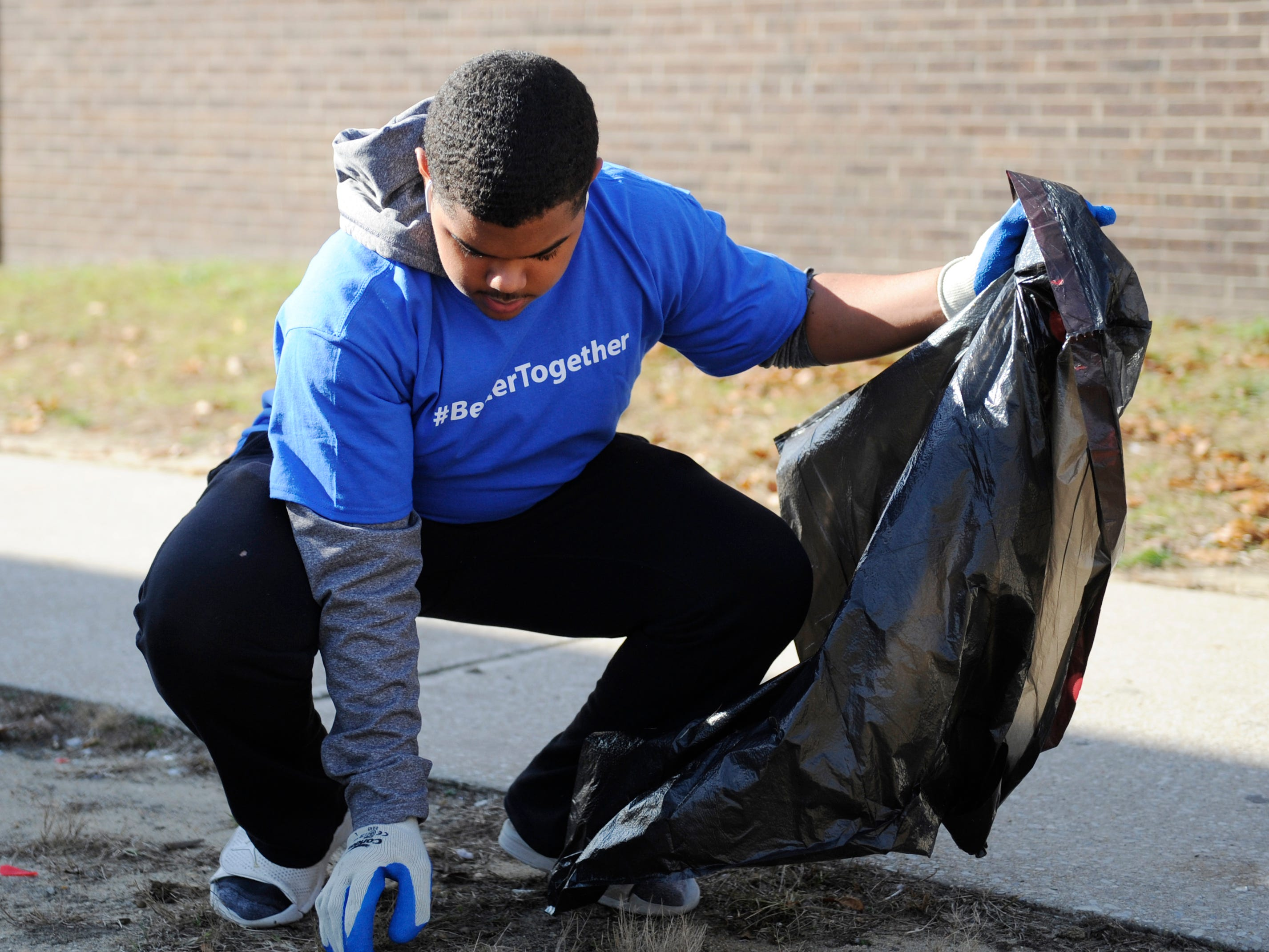Milton White helps out during a community clean up event at Oakview Apartments in Millville on Thursday, November 8, 2018.