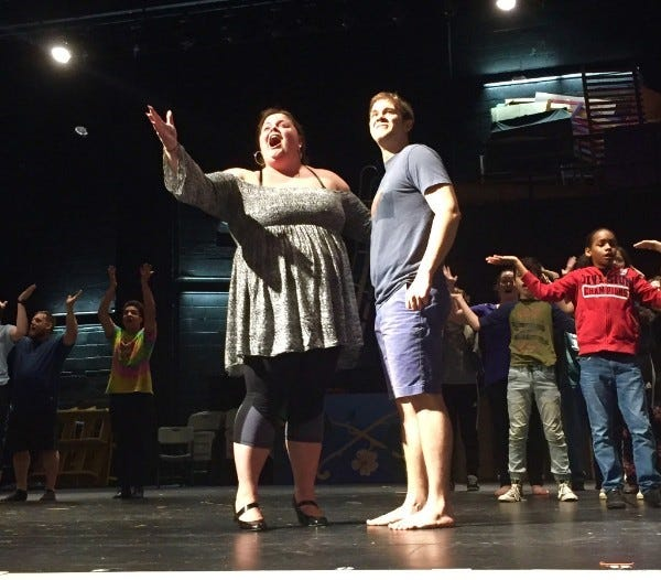 """Kate Layton as the Narrator encourages C.J. Jarema as Joseph to keep dreaming during a rehearsal for the Off Broad Street Players production of """"Joseph and the Amazing Technicolor Dreamcoat."""""""
