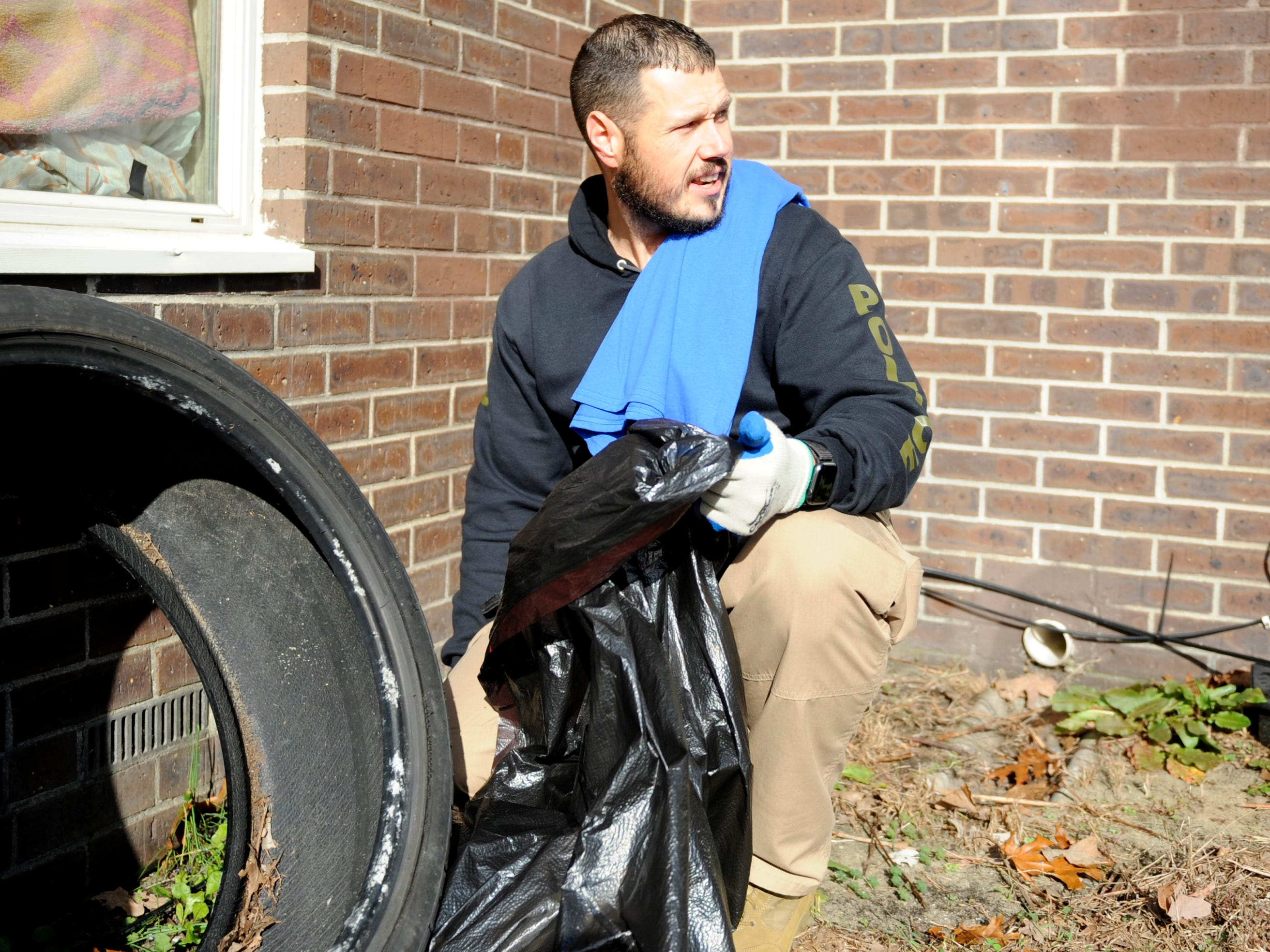 Member of the Millville police department participated in a community clean up event at Oakview Apartments on Thursday, November 8, 2018.