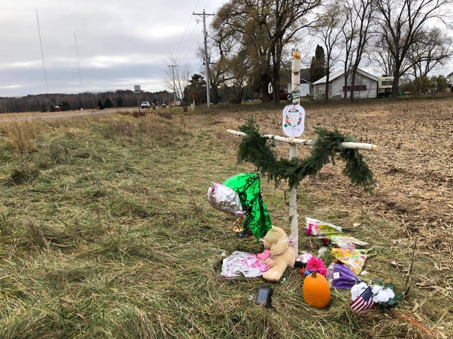A memorial to Girl Scout troop No. 3305 along Chippewa County Highway P, where three members of the troop and an adult volunteer were killed on Nov. 3.