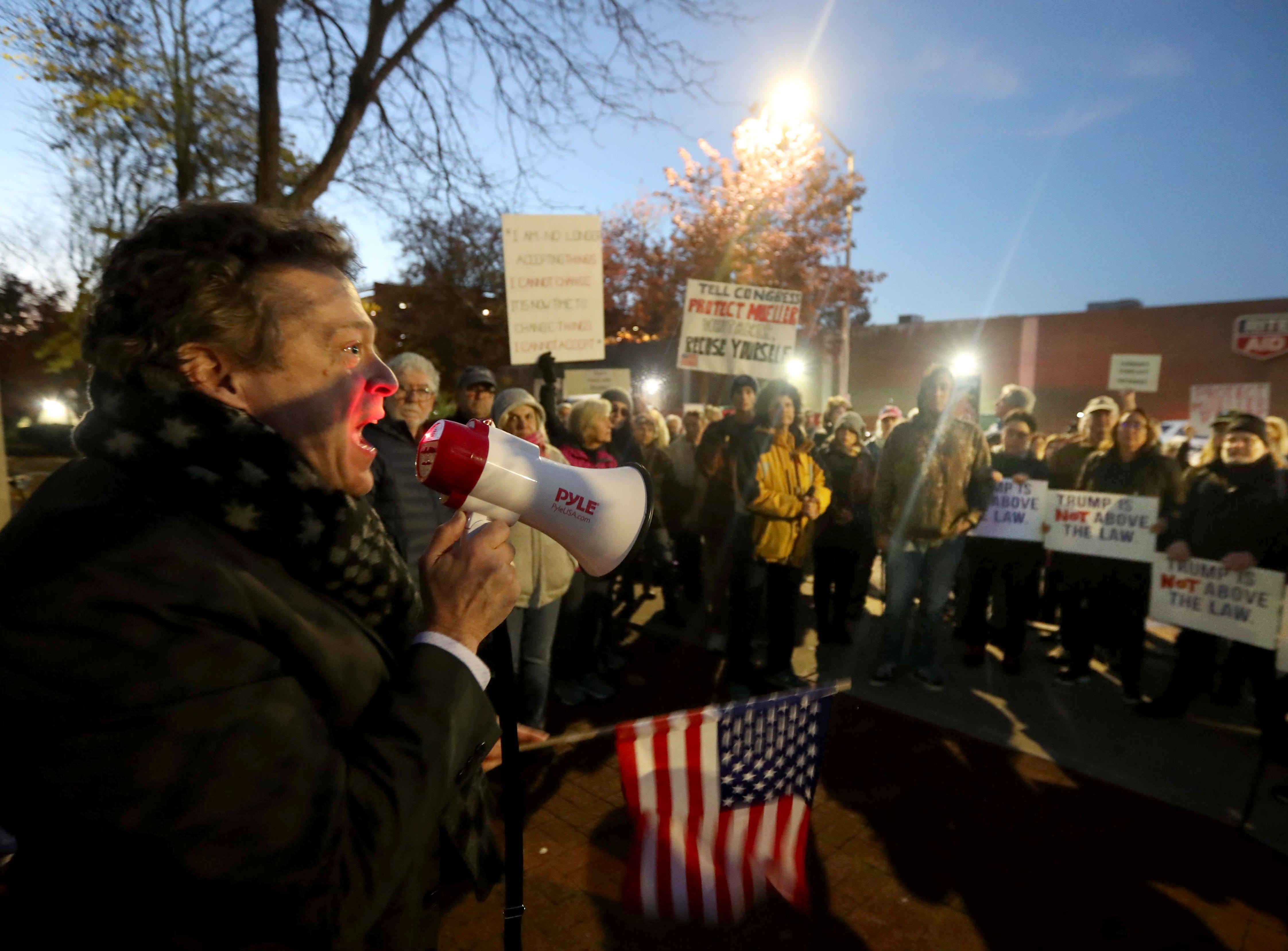 Robert Kesten of Lewisboro, N.Y. speaks to over one-hundred people in front of Senator Chuck Schumer's local office in Peekskill, N.Y. during a rally calling for the protection of the Robert Mueller's investigation Nov. 8, 2018. The protest coincided with similar protests across the nation and came in the wake of President Trump's firing of Attorney General Jeff Sessions.