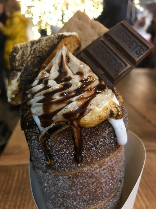 The Yule Want S'more artisan chimney cake from The Lodge at Bryant Park. This is nutella, graham cracker cheesecake whip, bruleed marshmallow, graham cracker and Hershey chocolate.