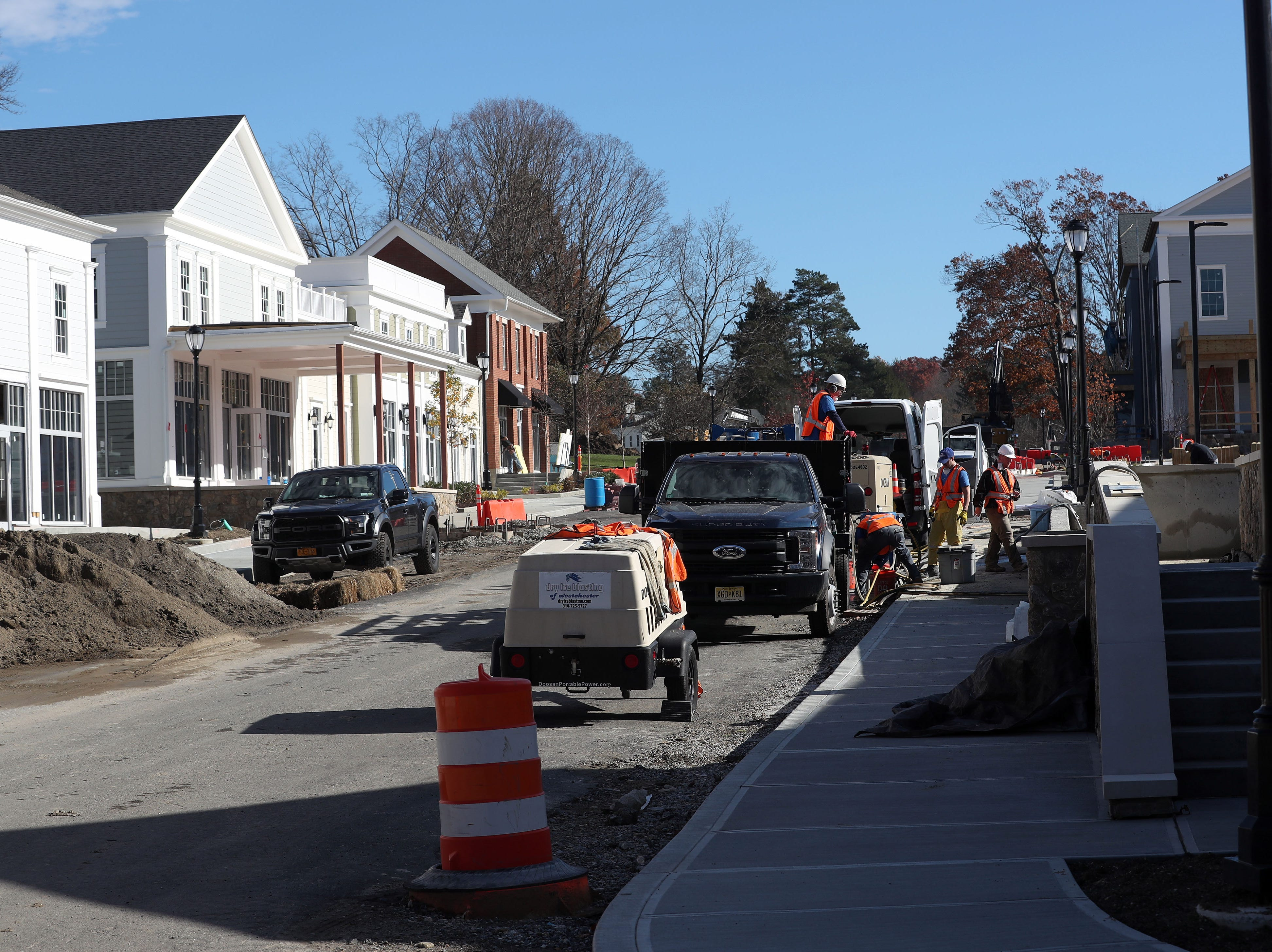 Sidewalks get some finishing touches at Chappaqua Crossing in Chappaqua Nov. 7,  2018.