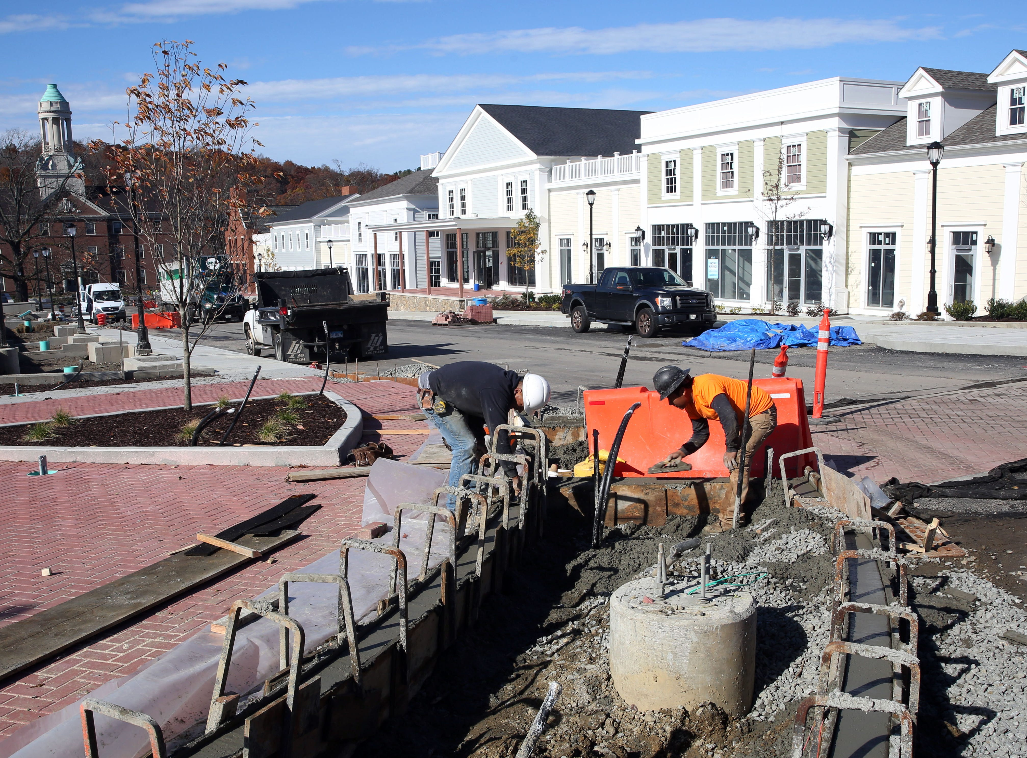 Workers prepare a sidewalk as construction continues at Chappaqua Crossing in Chappaqua Nov. 7,  2018.