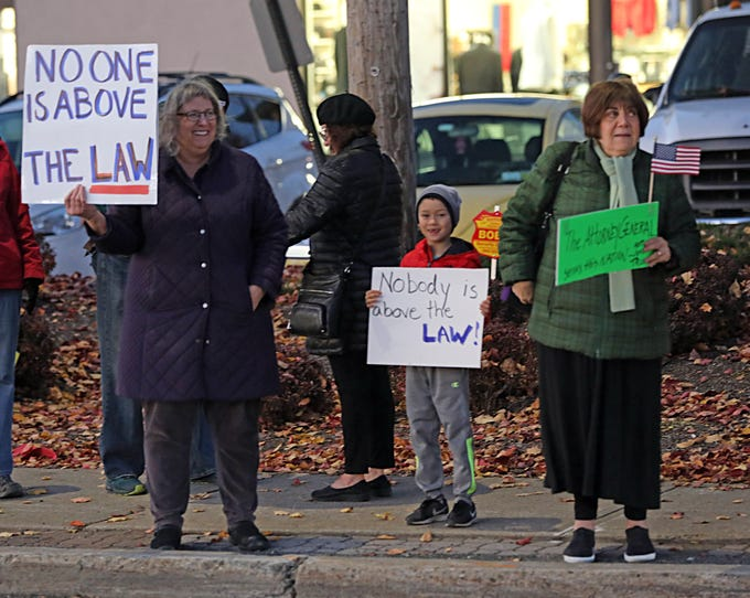 From left, Susan Glassman of Chestnut Ridge, her grandson, Kai Glassman, and Elaine Slotnick of Monsey rally Thursday for the protection of Robert Mueller's investigation on Route 59 in Nanuet. In the wake of U.S. Attorney General Jeff Sessions' firing on Wednesday, residents gathered to support Mueller's investigation.