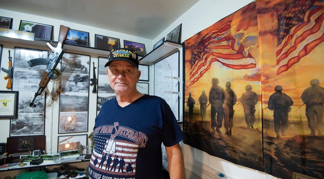 Ron Elliott of Wilmington, a U.S. Army veteran, has spent decades carrying the remains of deceased veterans to their final resting place in his truck at no charge.