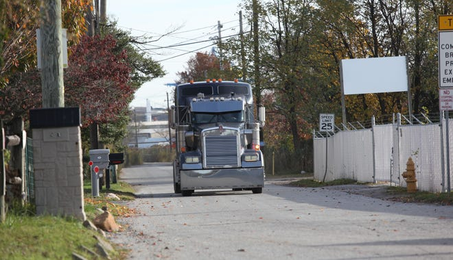 A tractor trailer drives down to Pyles Lane to Port-to-Port International.