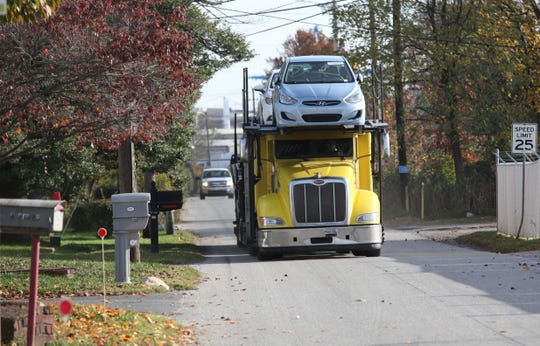 A car carrier drives down Pyles Lane to Port to Port International.  Residents on the street have been at odds with the company and DelDOT over the amount of truck traffic on the small street.