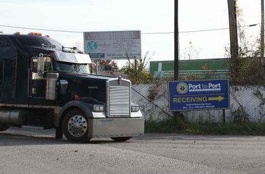 A tractor trailer pulls into Port-to-Port International on Pyles Lane.