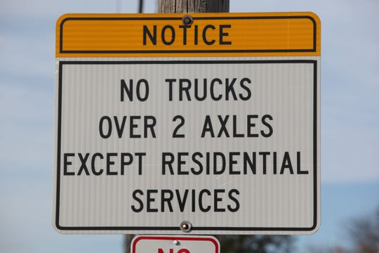 A sign on Pyles Lane  tells truckers not to use Pyles Lane if their vehicle has over axles.  The sign is often disregarded.