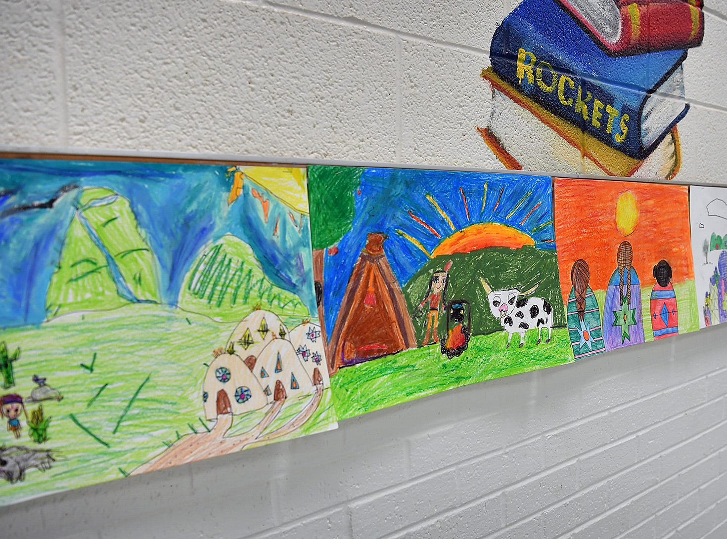 Artworks created by Fain Elementary students depict scenes celebrating Native American culture during National Native American Heritage month.