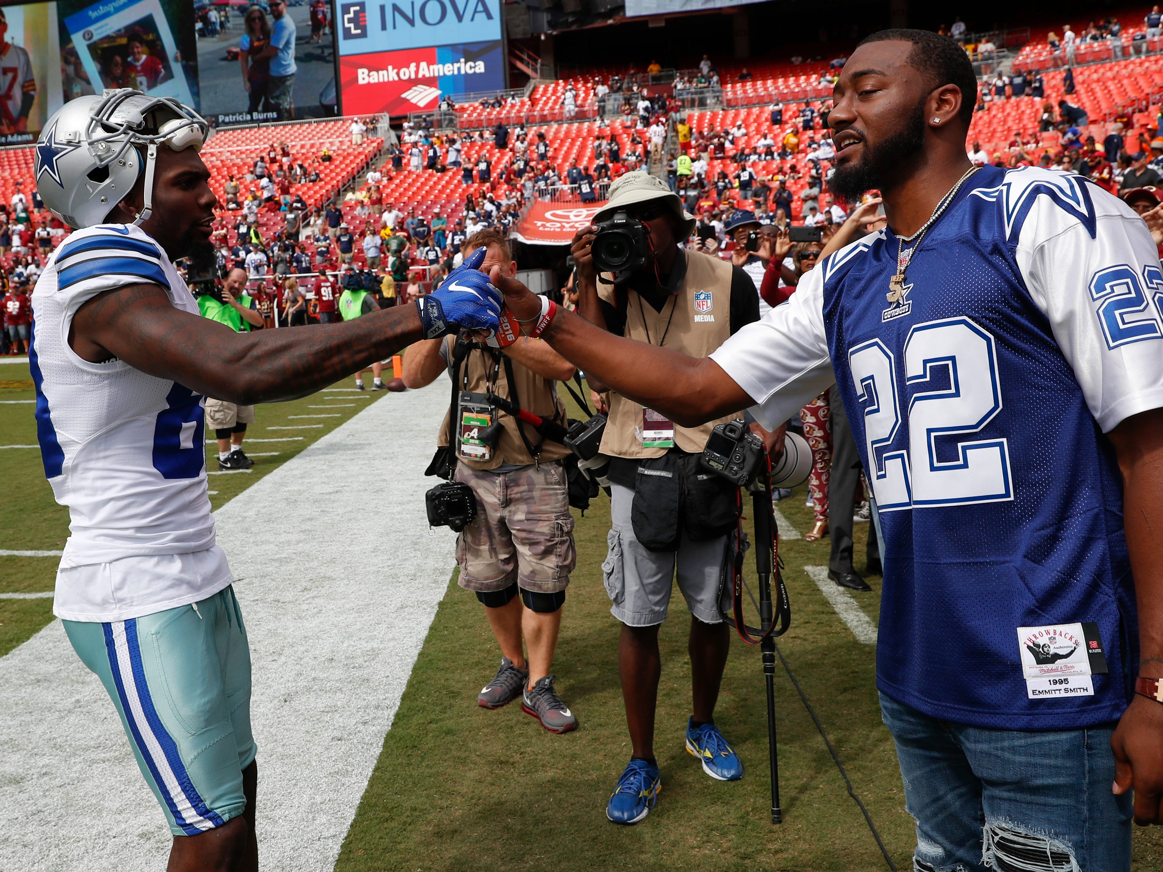 Dez Bryant greets Washington Wizards point guard John Wall before a game against the Washington Redskins in Landover, Md., in 2016.